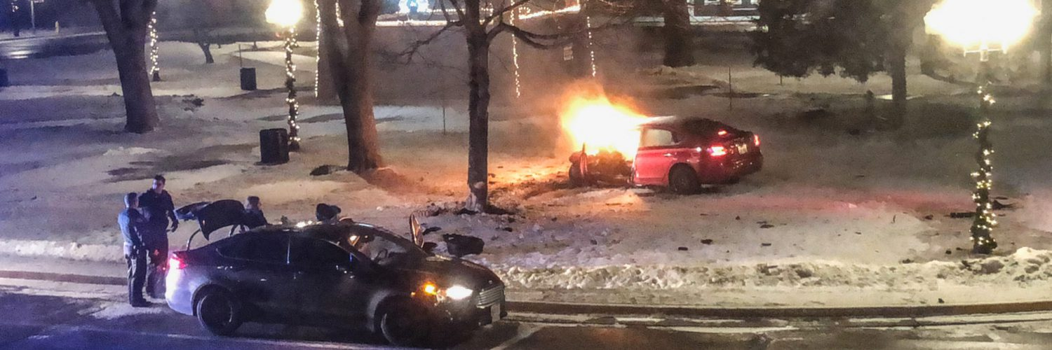 Car crash/fire on East Troy Square